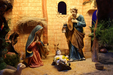 Christmas nativity scene with figurines including Jesus, Mary, Joseph, and sheeps