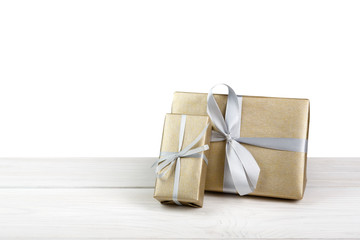 Christmas holiday gift boxes wrapped in paper isolated on white