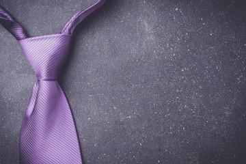 Elegant purple necktie. Top view