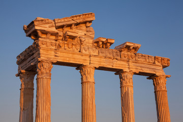 Ancient ruins of Roman Empire ( construction date about II century) at sunset.  .Apollo Temple, Side, Turkey.