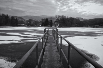 Black and White Pier on Frozen Lake in Winter