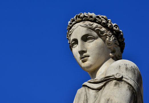 Classical roman or greek goddess statue with copy space