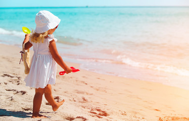 little girl walking on summer tropical beach