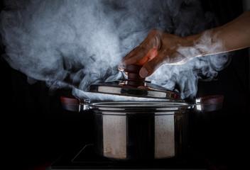 hand open hot steam pot