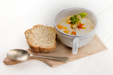 scottish fish soup in a cup and two slices of soda bread