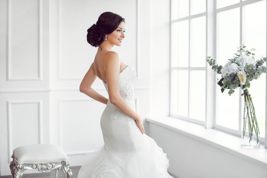 Beautiful bride. Wedding hairstyle make-up luxury fashion dress concept