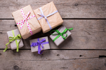 Festive gift boxes with presents on aged  wooden background.