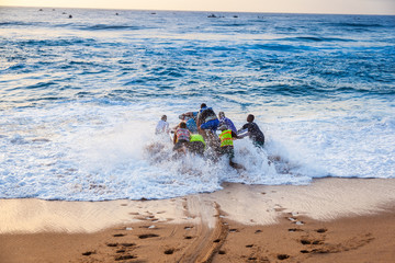 Jetski fishermen launch a personal watercraft into the sea at Ballito for a day of fishing. South Africa.