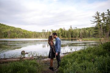 Couple rubbing noses by lake, Ottawa, Ontario