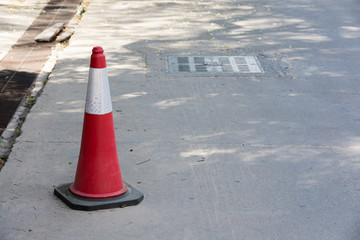 signaling traffic cone on the road