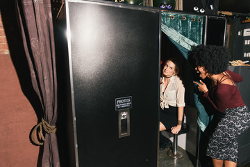 Women using photo booth
