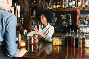 Bartender working behind bar in pub