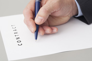 Businessman Writing a Contract