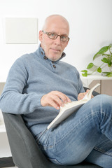 handsome mature man read a book