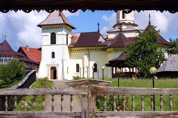 Orthodox monastery at gura humorului with wooden gates, suceava, romania
