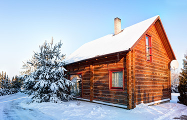 Traditional wooden house in the snow. Winter in Europe. Lithuania.