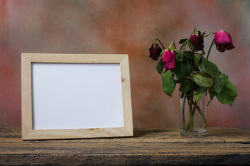 Empty wood picture frame on table