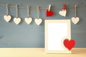 Blank photo frame with red heart