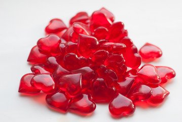 bunch of candy in heart shaped small red candy on white background,