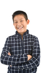 Portrait of Asian boy laughing on white.