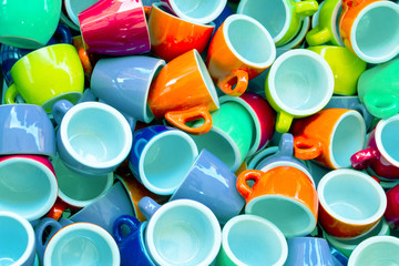 Heap of colorful cups for espresso coffee - concept of coffee ad