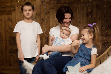Mother and two daughters and son in the studio