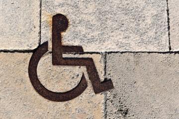 Pictogramme au sol pour place réservée aux handicapés
