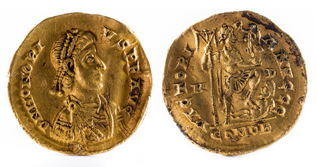 Ancient Roman gold solidus coin of Emperor Honorius.