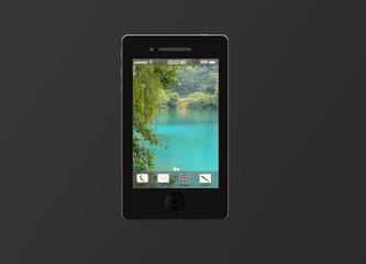 Черный мобильный телефон с картинкой на экране, на сером фоне
