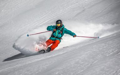 A skier on a mountain.