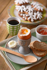 soft-boiled egg with slices of bread for breakfast