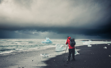 Photographer on a beach in Iceland.