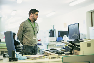 Man working at office in realistic environment
