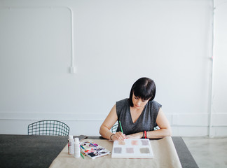 An artist at work in her studio.