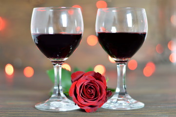 Valentines Day rose and two glasses of wine