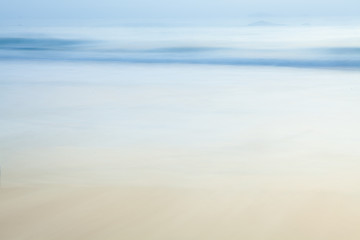 Abstract blurry background of beach and sea waves in the morning with vintage color style.