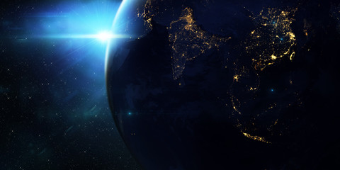 Blue sunrise, view of earth from space/Planet earth sunrise meets the city lights. Some elements of this image furnished by NASA