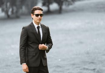 Man wearing suit.