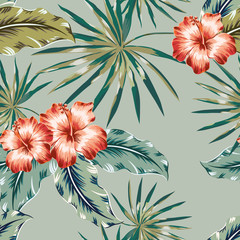 Red hibiscus flowers and palm leaves on the khaki background. Tropical vector seamless pattern.