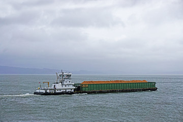 Wall Mural - pusher tug and barge going up the Columbia river in Astoria Oregon