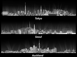 Fototapete - Tokyo, Seoul, Sydney and Auckland skylines at night in grey scales