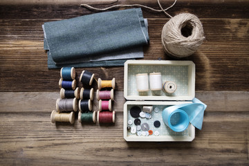 Overhead view of fabric with sewing equipment on table