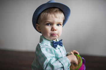 Portrait of cute baby boy sitting at home