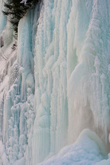 Frozen Waterfall with water gushing through the ice