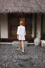 Rear view of woman entering tourist resort