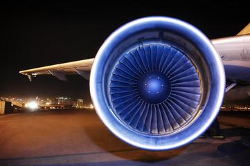 Aircraft jet engine on runway at night