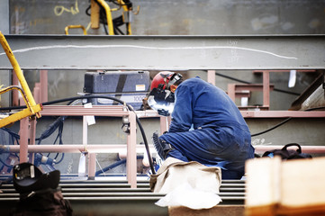 Side view of worker working at shipyard