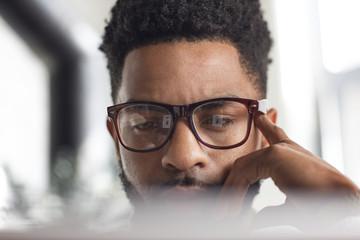 Close up of man using laptop at home