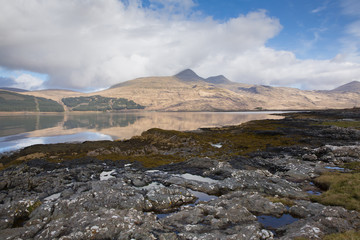 Isle of Mull Scotland UK beautiful Loch Scridain with view to Ben More and Glen More mountains on calm spring day