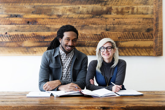 Portrait of smiling business colleagues sitting in office